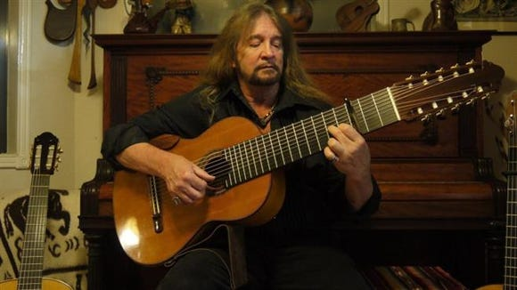 Craig Alden Dell performs on the 10-string guitar custom made for him by luthier Michael Elwell.