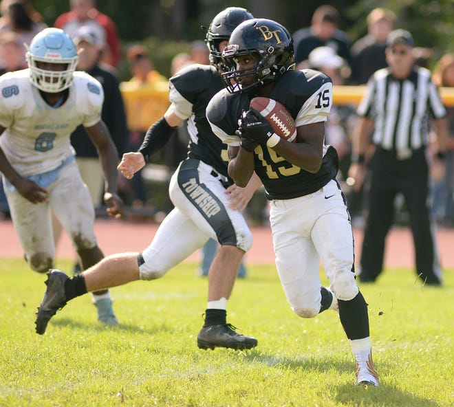 Burlington Township's Rodney Vines runs the ball during a 14-13 win over Highland on Saturday.