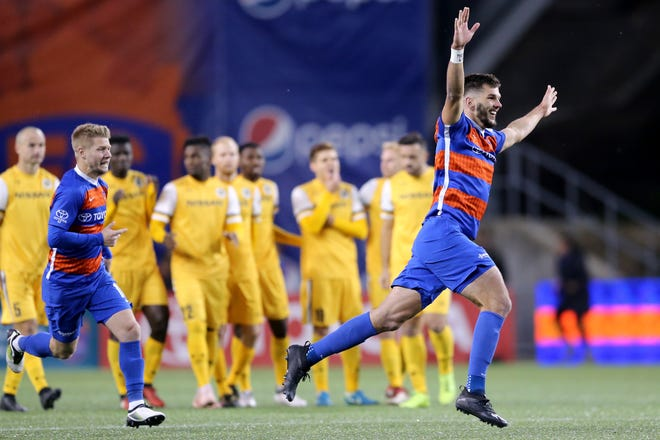 FC Cincinnati Forrest Lasso (3) reacts after winning 6-5 in the penalty shootout during a USL soccer playoff game between Nashville SC and FC Cincinnati,Saturday, Oct. 20, 2018, at Nippert Stadium in Cincinnati. FC Cincinnati won 6-5 on penalties.