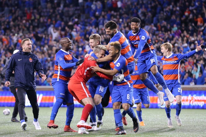 FC Cincinnati goalkeeper Spencer Richey (18) is embraced by teammates after winning 6-5 on penalty kicks during a USL soccer playoff game between Nashville SC and FC Cincinnati,Saturday, Oct. 20, 2018, at Nippert Stadium in Cincinnati. FC Cincinnati won 6-5 on penalties.
