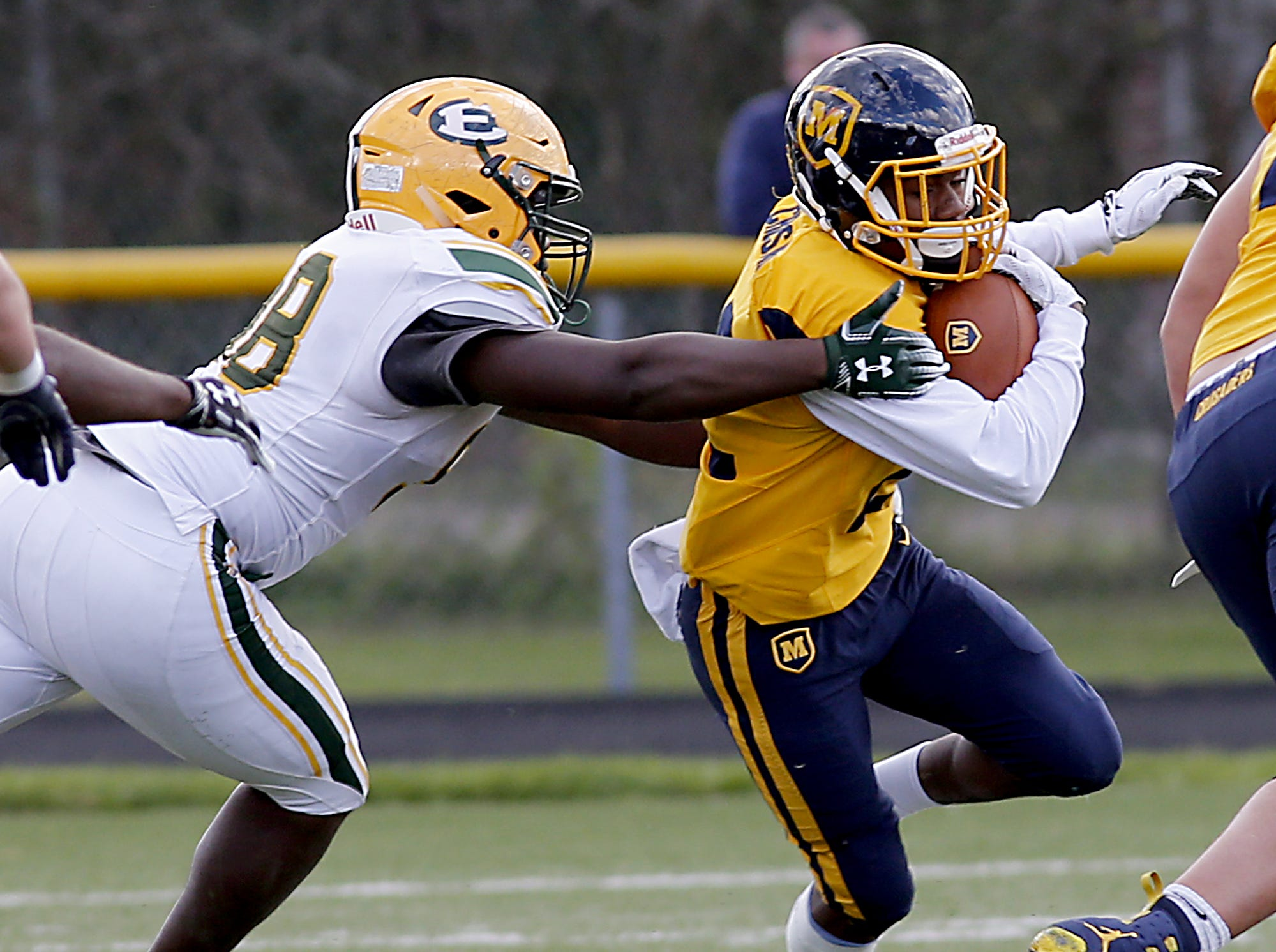 Moeller running back Bryan White is caught by Lakewood St. Edward lineman Terron Lee during their game at Lockland Saturday, Oct. 20, 2018. E.L. Hubbard for the Enquirer