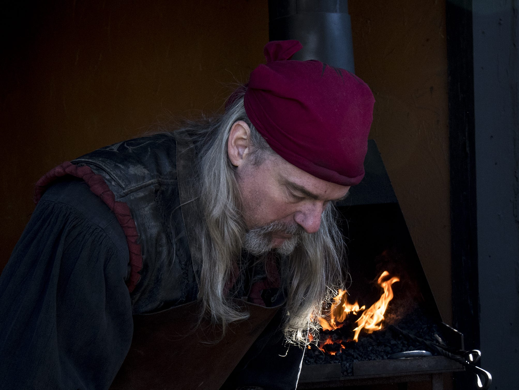 Vincent Krava, owner of Dragon's Head Forge, showcases his talent as a blacksmith during the Ohio Renaissance Festival Sunday, October 21, 2018 in Waynesville, Ohio.