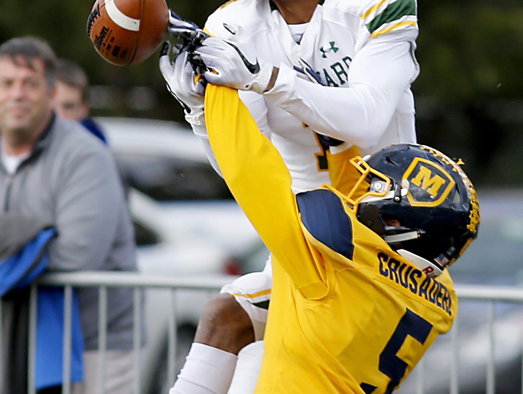 Moeller defensive back B.J. Hendrix, Jr., breaks up the pass meant for Lakewood St. Edward wide receiver Quintel Kent during their game at Lockland Saturday, Oct. 20, 2018.