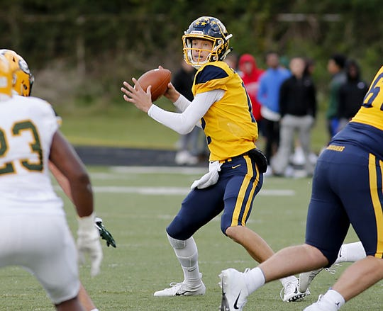Moeller quarterback Mitch McKenzie looks down field against Lakewood St. Edward during their game at Lockland Saturday, Oct. 20, 2018.