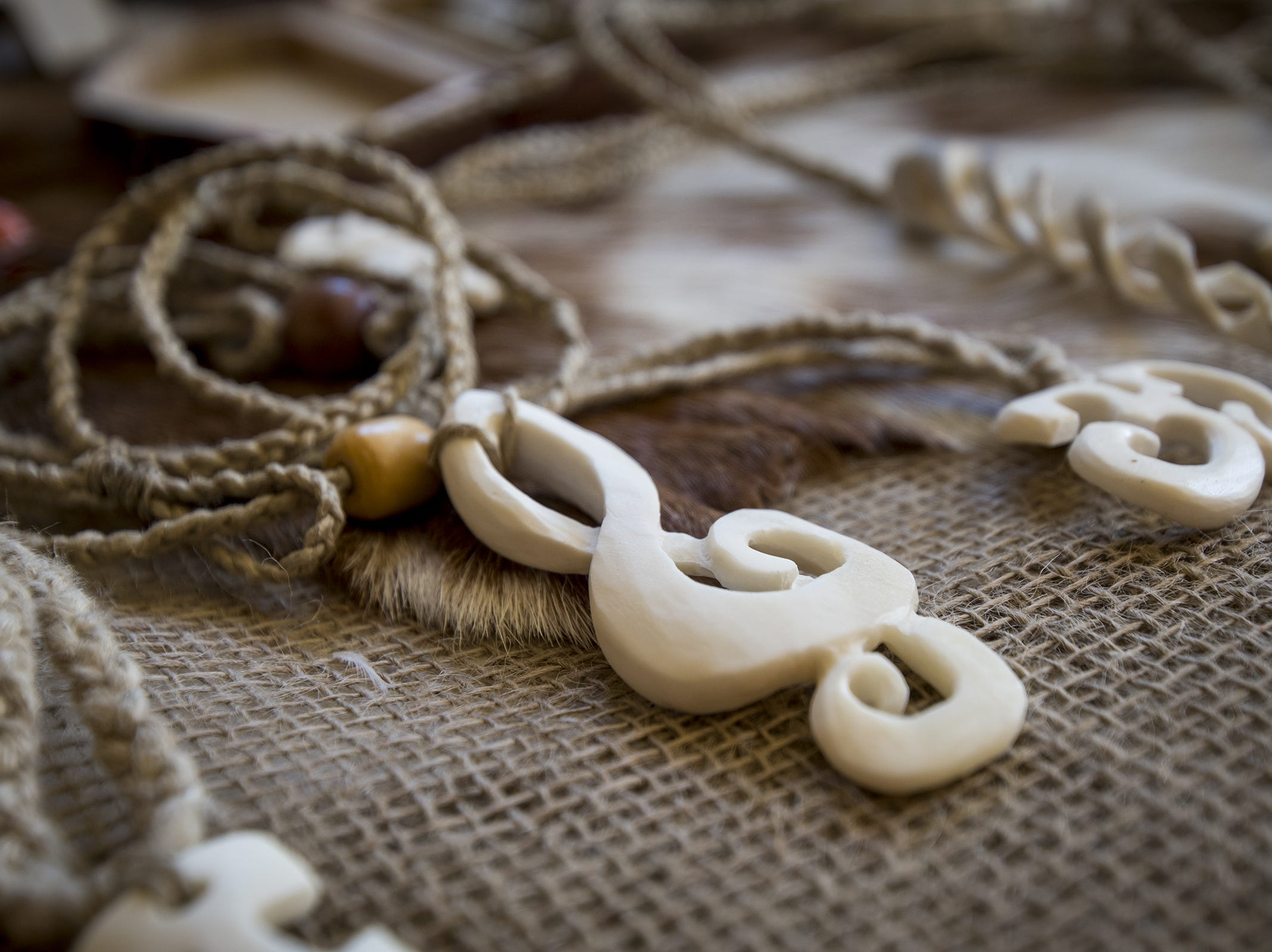 Handmade necklaces are laid out at Tula's Bone Carving the Ohio Renaissance Festival Sunday, October 21, 2018 in Waynesville, Ohio.
