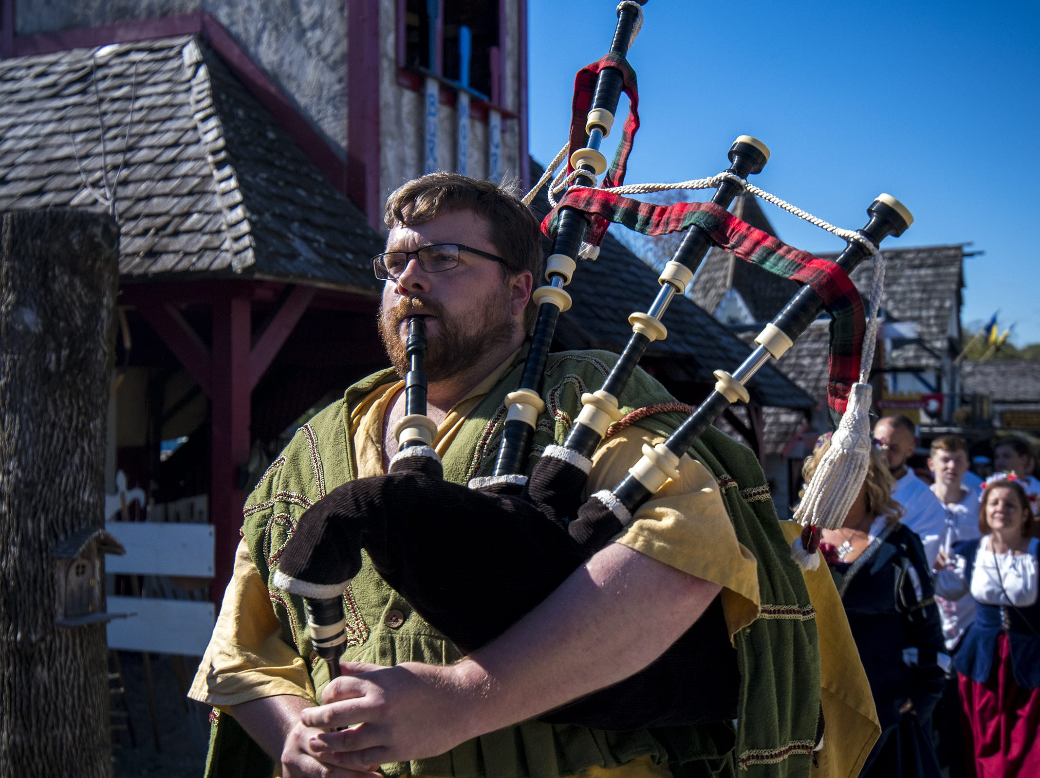 A bagpiper leads a wedding party to the chapel during Romance Weekend at the Ohio Renaissance Festival Sunday, October 21, 2018 in Waynesville, Ohio.