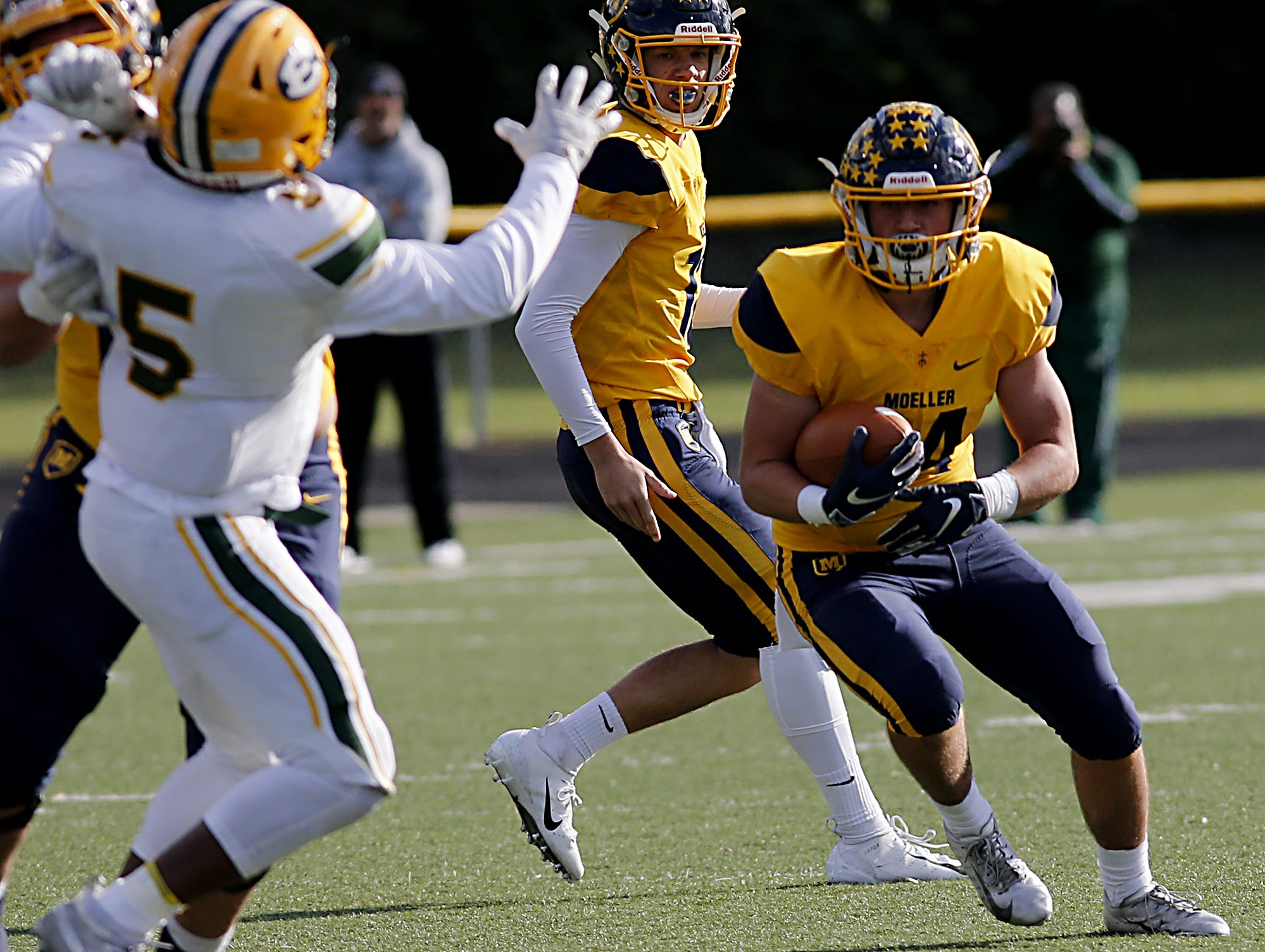 Moeller running back Thomas Rotello carries the ball against Lakewood St. Edward during their game at Lockland Saturday, Oct. 20, 2018.