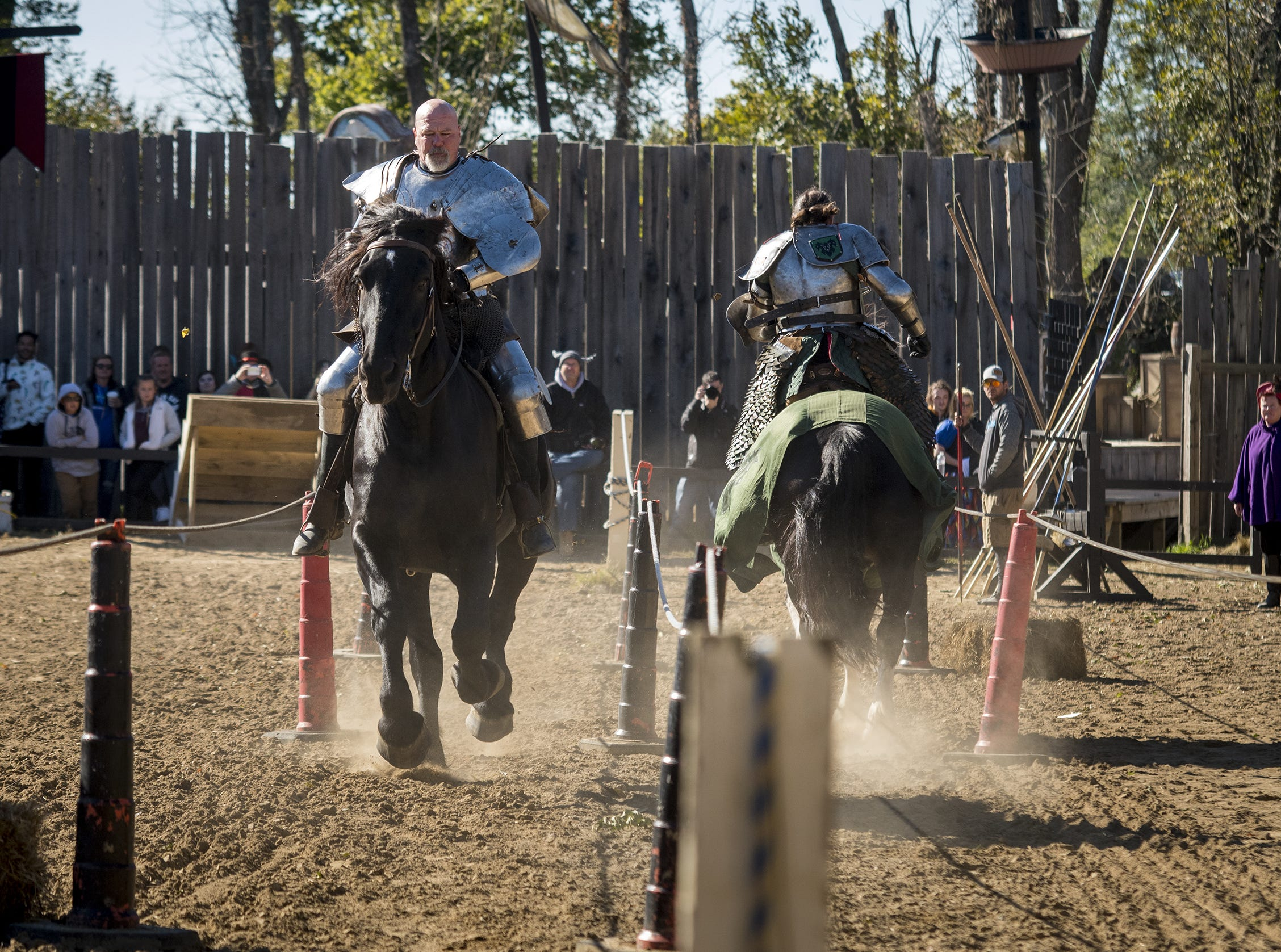Sir Theodore and Sir Robert ride through the lists during the live jousting show at the Ohio Renaissance Festival Sunday, October 21, 2018 in Waynesville, Ohio.