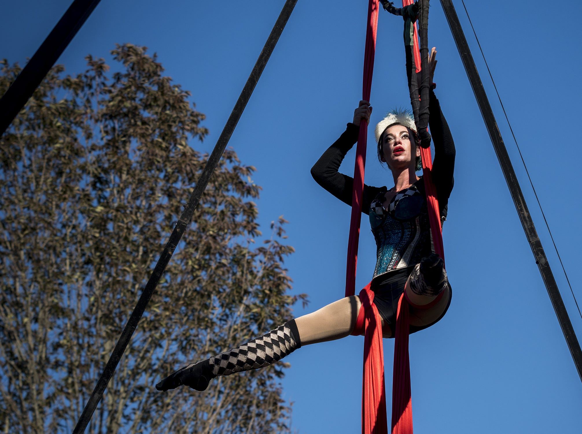 Jen, of Cirqa Brava shows off her acrobatic skill on the silks during Romance Weekend at the Ohio Renaissance Festival Sunday, October 21, 2018 in Waynesville, Ohio.