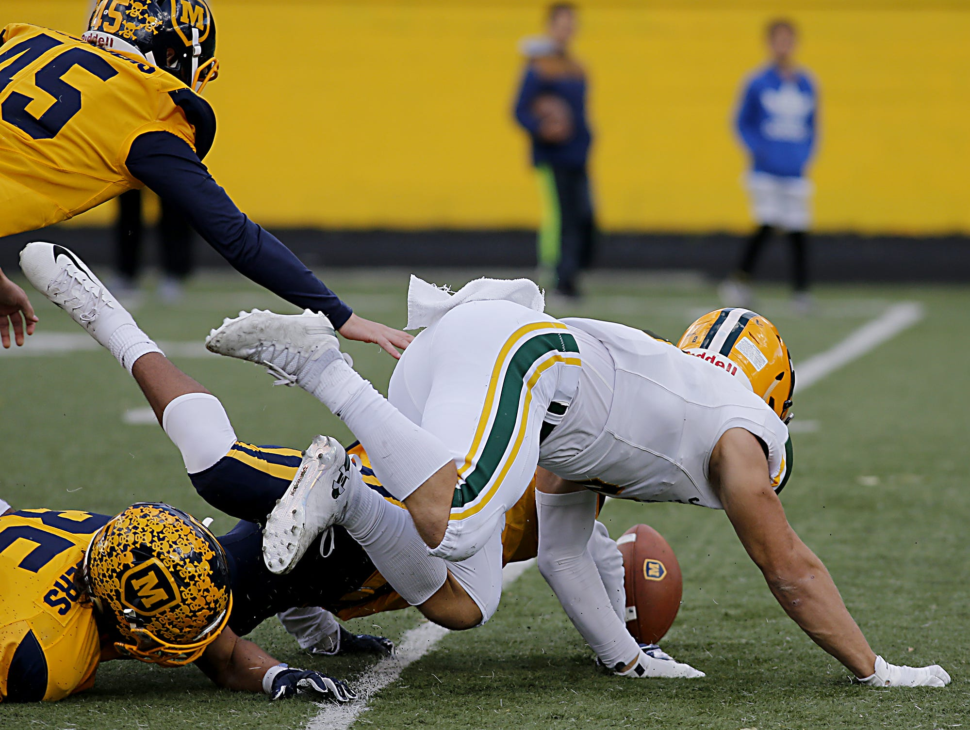 Lakewood St. Edward looses the ball and Moeller recovers during their game at Lockland Saturday, Oct. 20, 2018.
