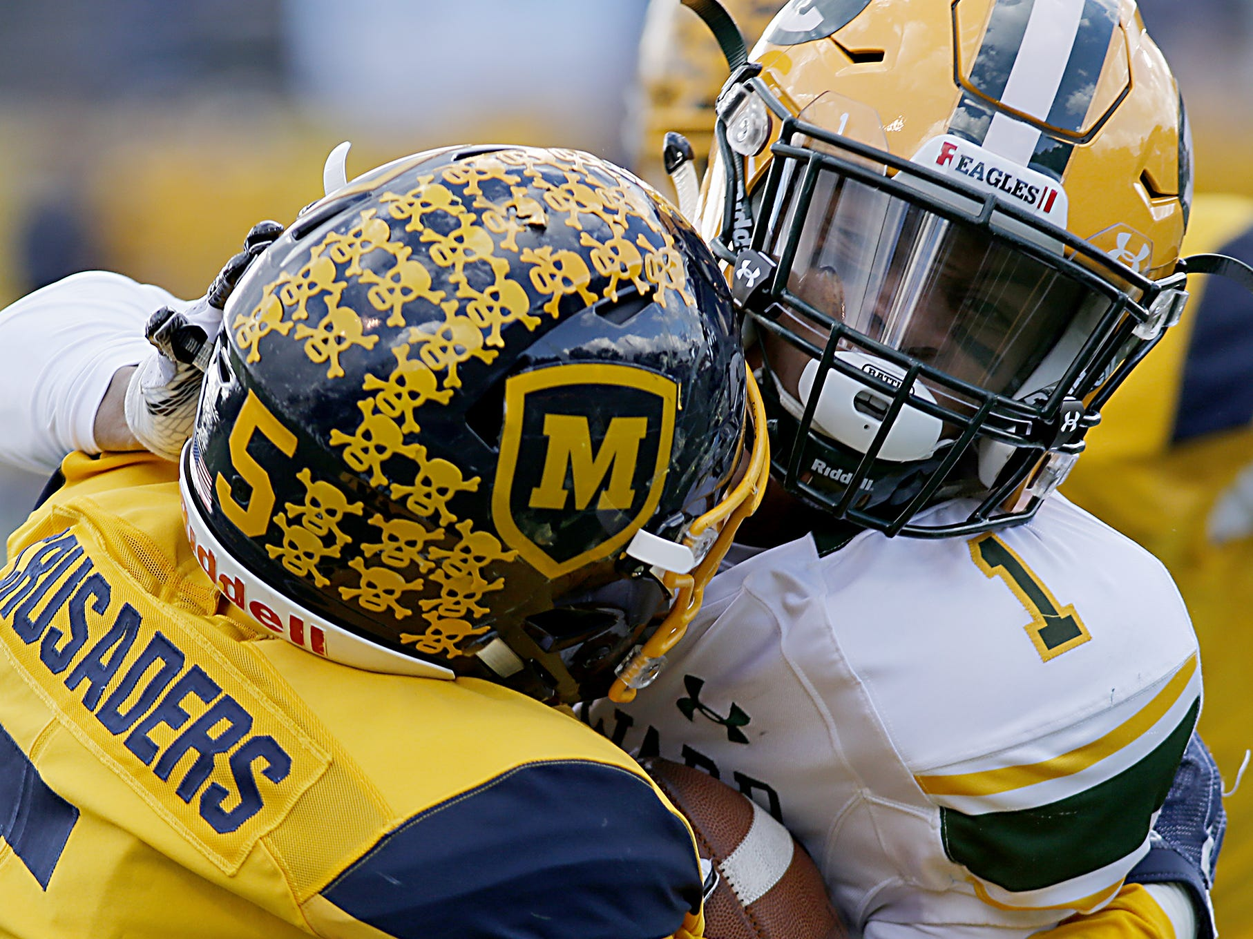 Moeller defensive back B.J. Hendrix, Jr., wraps up Lakewood St. Edward ball carrier Quintel Kent during their game at Lockland Saturday, Oct. 20, 2018.