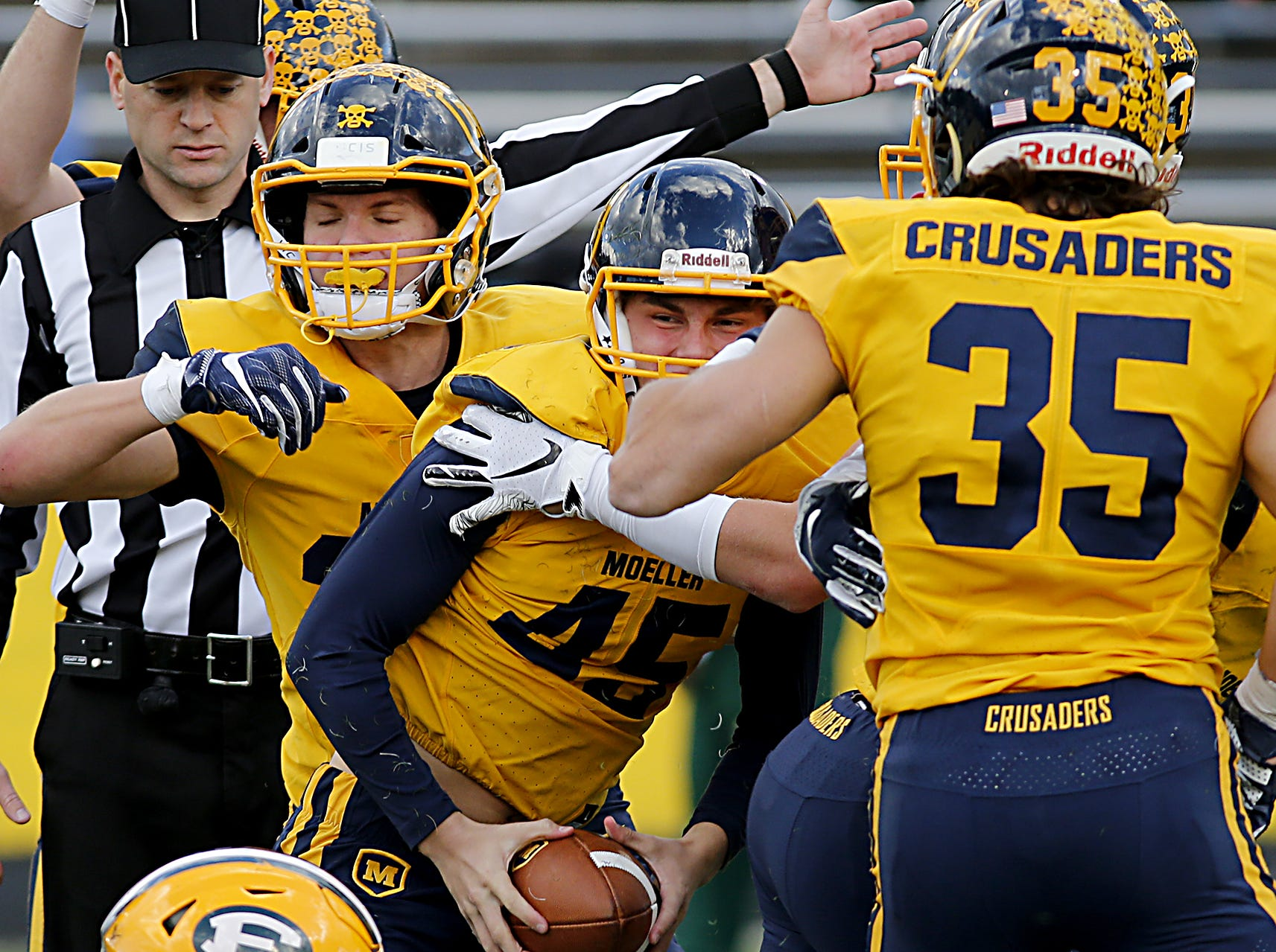 Moeller defensive back Tony Mock recovers a Lakewood St. Edward fumble during their game at Lockland Saturday, Oct. 20, 2018.