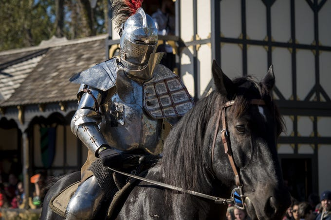 Sir Robert dons his helmet and more protective armor during the live jousting show at the Ohio Renaissance Festival Sunday, October 21, 2018 in Waynesville, Ohio.