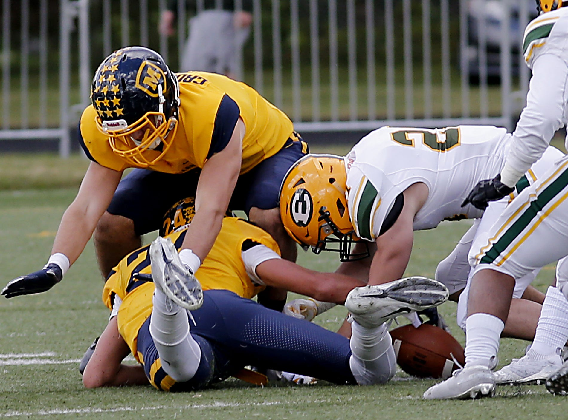 Moeller defensive back Braedon Junker can't recover a fumble as Lakewood St. Edward lands on the loose ball during their game at Lockland Saturday, Oct. 20, 2018.