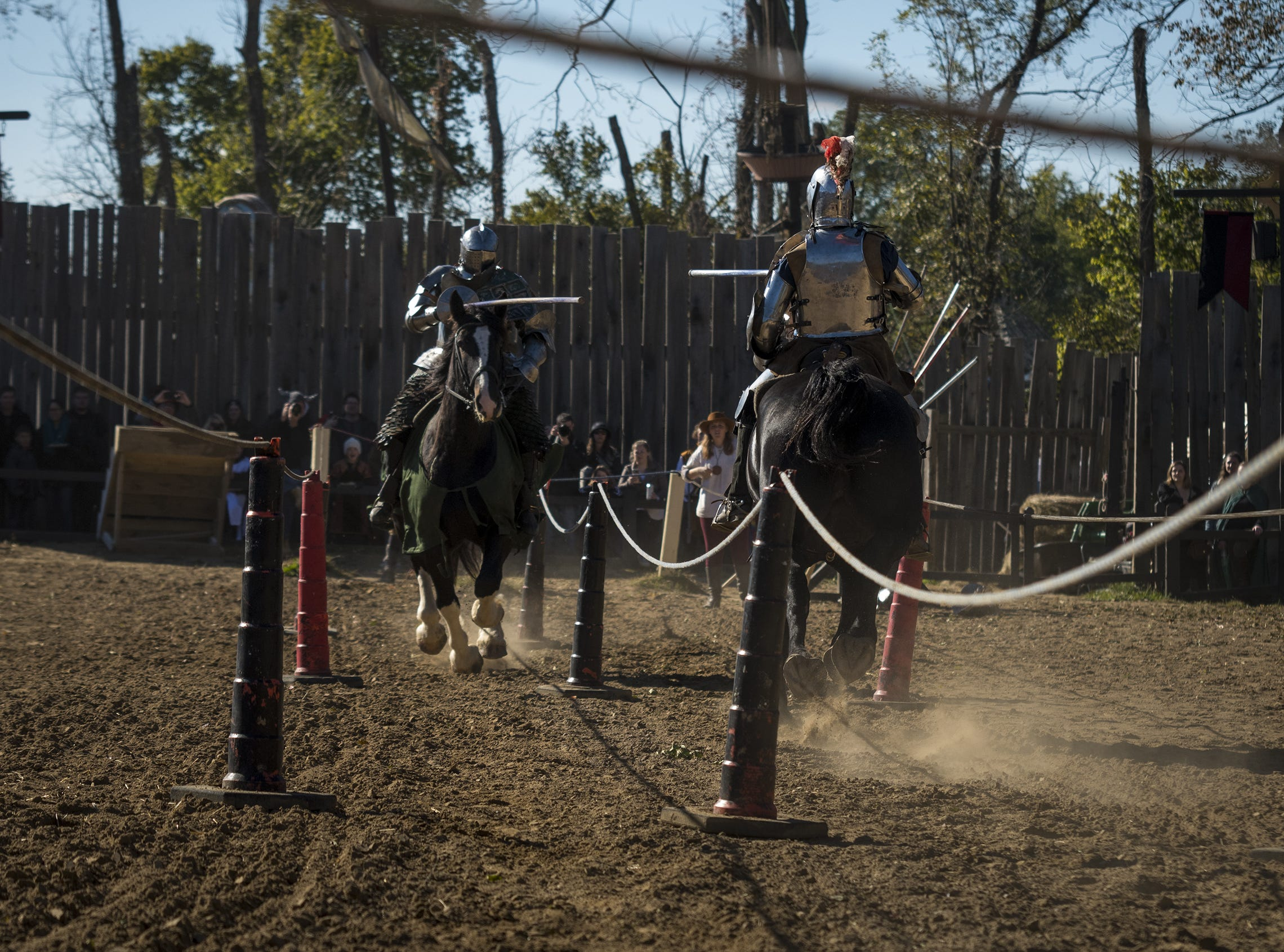 Sir Theodore and Sir Robert take aim during the live jousting show at the Ohio Renaissance Festival Sunday, October 21, 2018 in Waynesville, Ohio.