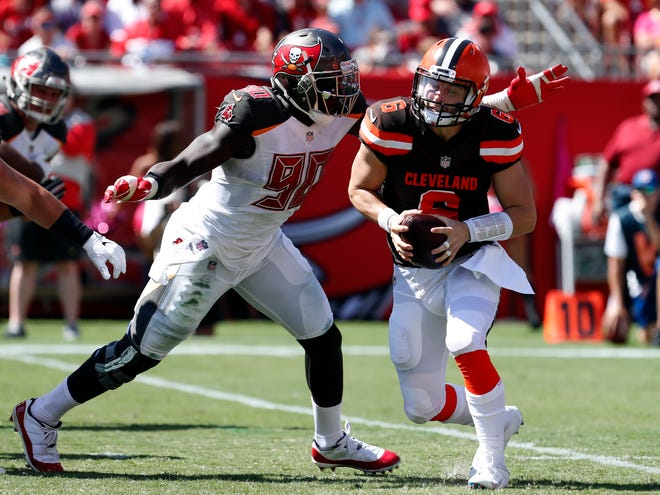Tampa Bay Buccaneers defensive end Jason Pierre-Paul (90) pressures Cleveland Browns quarterback Baker Mayfield (6) during the first half of an NFL football game Sunday, Oct. 21, 2018, in Tampa, Fla.