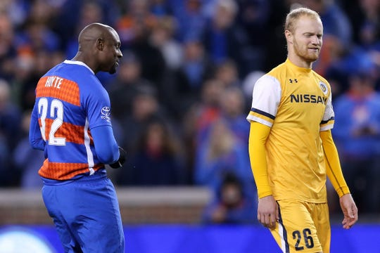 FC Cincinnati defender Justin Hoyte (32) talks trash to Nashville SC midfielder London Woodberry (28) in the penalty shootout during a USL soccer playoff game between Nashville SC and FC Cincinnati,Saturday, Oct. 20, 2018, at Nippert Stadium in Cincinnati. FC Cincinnati won 6-5 on penalties.