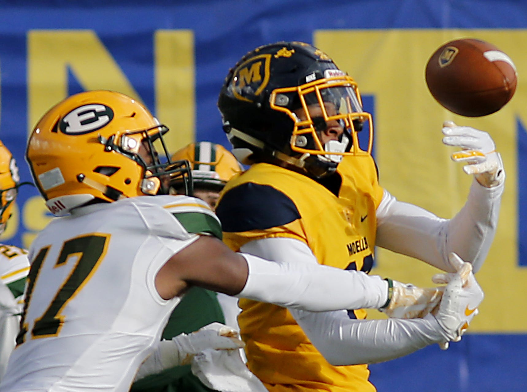 Lakewood St. Edward defensive back Logan Nash breaks up the pass meant for Moeller wide receiver Carrington Valentine during their game at Lockland Saturday, Oct. 20, 2018.