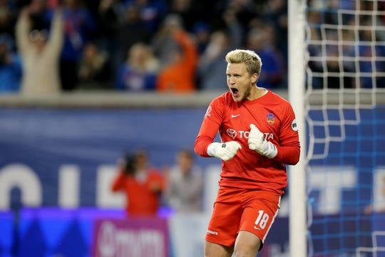 FC Cincinnati goalkeeper Spencer Richey (18) reacts after a missed penalty kick in the penalty shootout during a USL soccer playoff game between Nashville SC and FC Cincinnati,Saturday, Oct. 20, 2018, at Nippert Stadium in Cincinnati. FC Cincinnati won 6-5 on penalties.