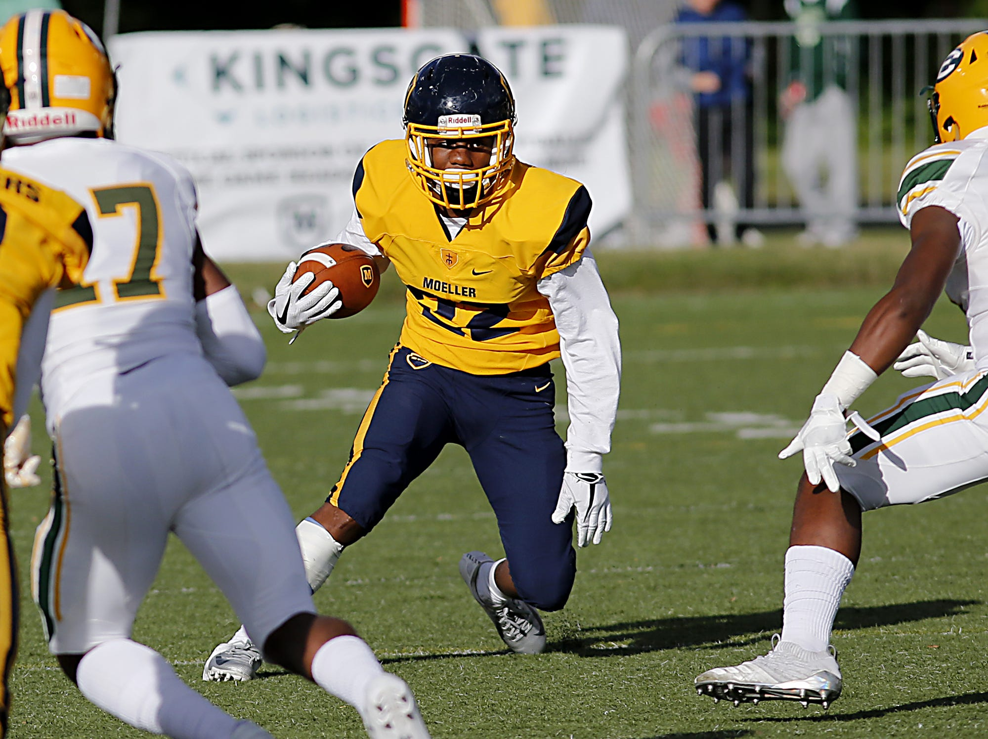 Moeller running back Bryan White looks for running room against Lakewood St. Edward during their game at Lockland Saturday, Oct. 20, 2018.