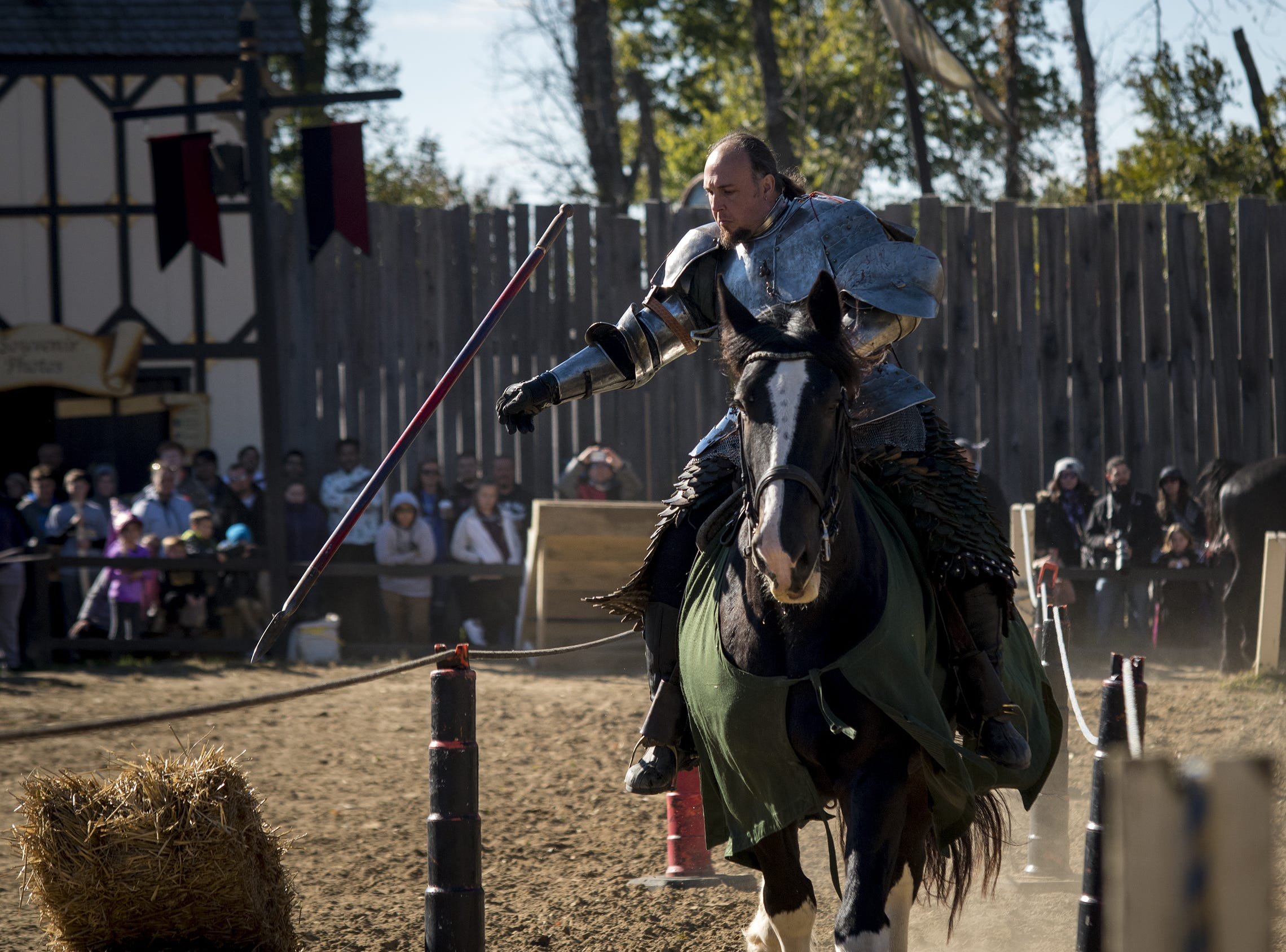 Sir Theodore throws a javelin at a target during the live jousting show at the Ohio Renaissance Festival Sunday, October 21, 2018 in Waynesville, Ohio.