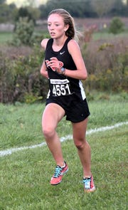 Jenna Burns of New Richmond claimed first place in the DII-A girls race at the Southwest District Cross Country Championships, October 20, 2018.