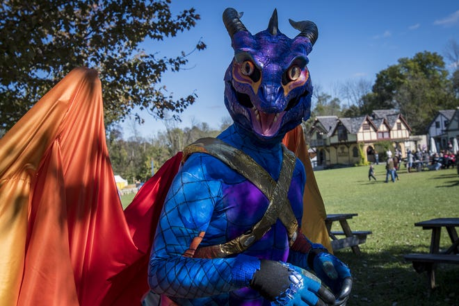 A dragon wanders around the Ohio Renaissance Festival Sunday, October 21, 2018 in Waynesville, Ohio.