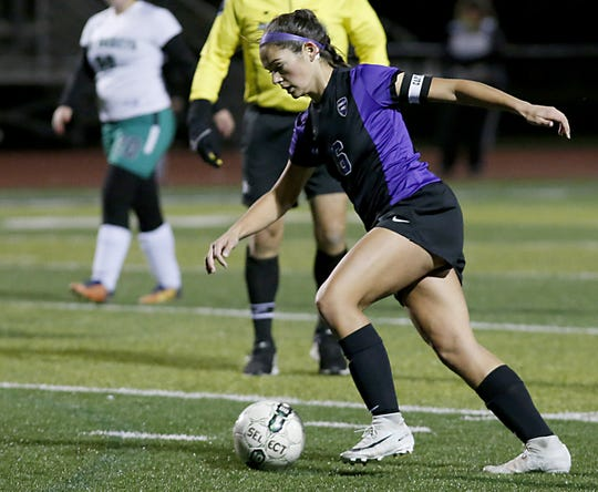 Cincinnati Hills Christian Academy senior Alaina Huber sets up her kick for her 100th goal during their game against Fayetteville-Perry High School at CHCA in Cincinnati Saturday, Oct. 20, 2018.