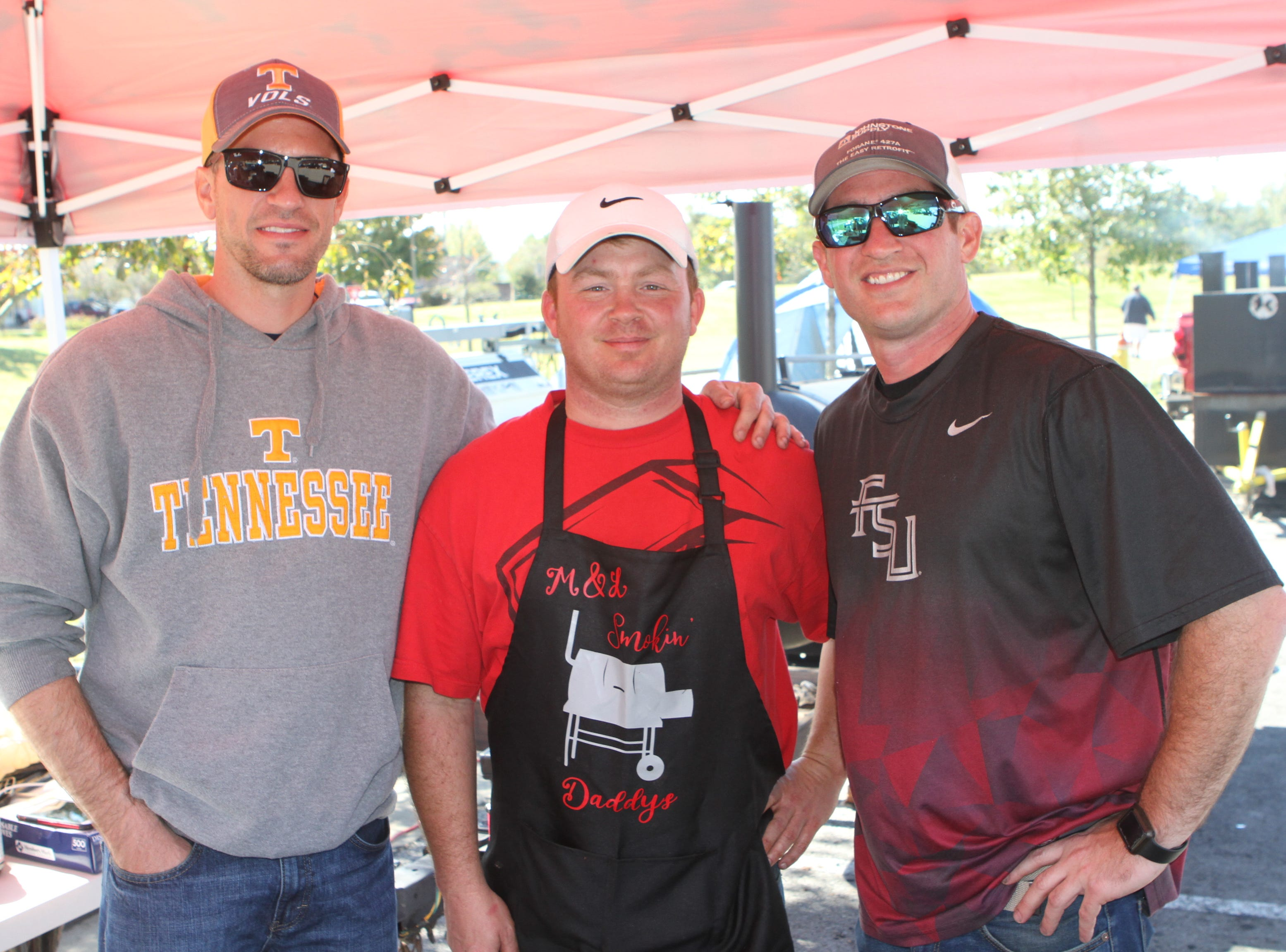 Jesse Whitley, Kenny Rice and James Sherrill competing at the annual BBQ Bash at Liberty Park on Saturday, October 20, 2018.