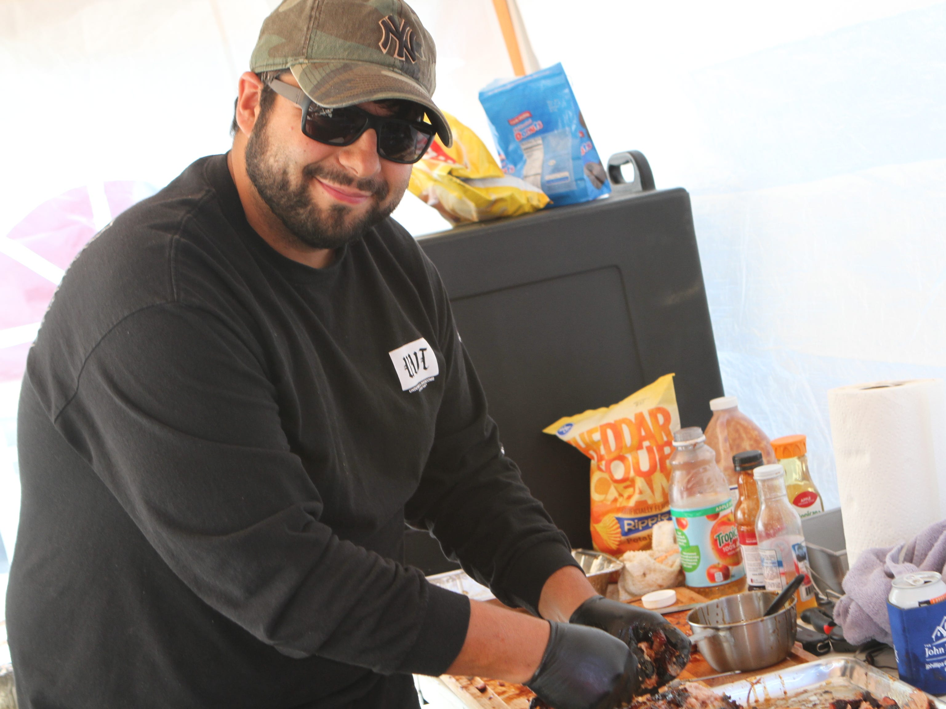 Travis Sumruld of the Pig Destroyer Competition BBQ Team at the annual BBQ Bash at Liberty Park on Saturday, October 20, 2018.