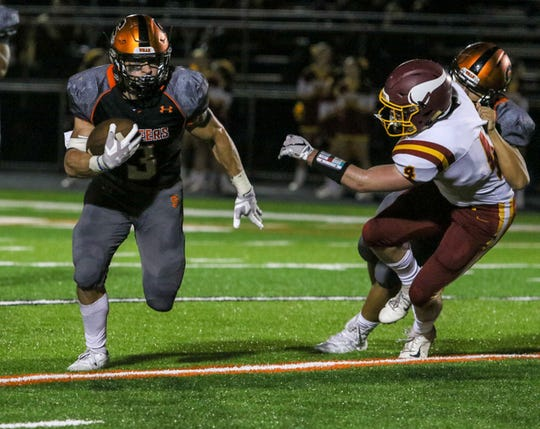 Somerville's Robert Fiorentino runs the ball as Voorhees defends during the first half of a  football at Somerville High School on September 21, 2018.  Alexandra Pais/ for the Courier News