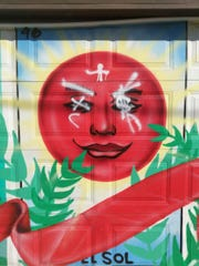 Three murals located on East Grand Avenue were defaced with racist graffiti last week.