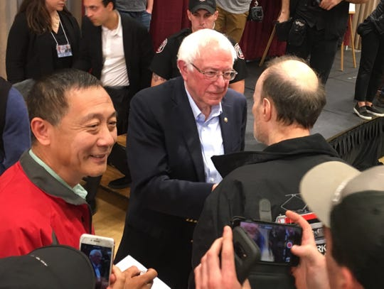 Sen. Bernie Sanders meets with people after speaking Sunday, Oct. 21, 2018, at Iowa State University in Ames, Iowa