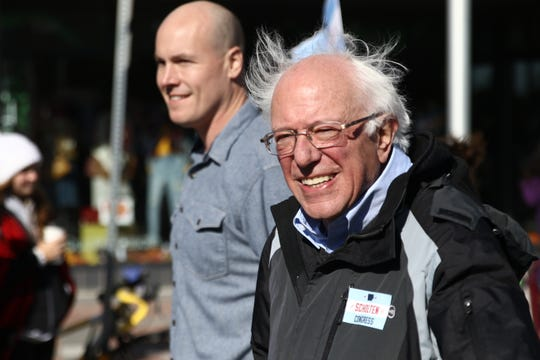 U.S. Sen. Bernie Sanders, of Vermont, rallied Iowa Democrats in Ames, Iowa, on Sunday, Oct. 21, 2018, on behalf of J.D. Scholten, left, who is challenging U.S. Rep. Steve King, R-Kiron, to represent Iowa's 4th Congressional District.