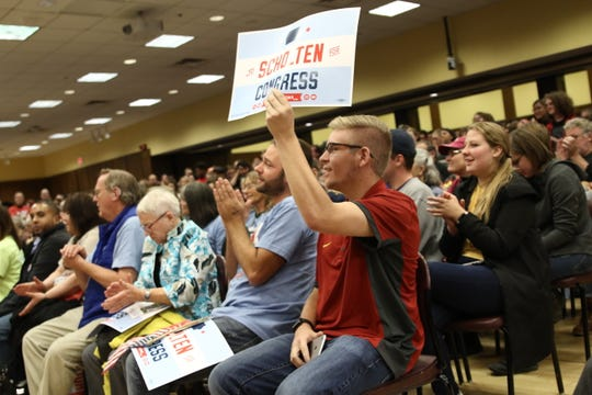 A crowd applauds as U.S. Sen. Bernie Sanders, of Vermont rallies supporters in the Memorial Union at Iowa State University in Ames, Iowa, on Sunday, Oct. 21, 2018. Sanders was in town to rally Iowa Democrats on behalf of J.D. Scholten, the Democrat challenging U.S. Rep. Steve King, R-Kiron, to represent Iowa's 4th Congressional District.