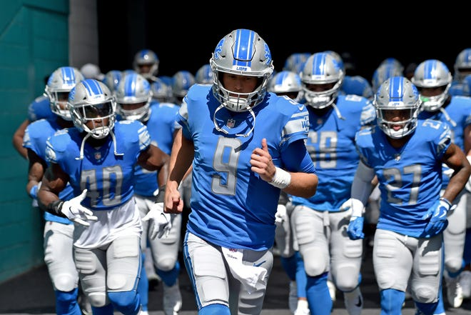 Lions quarterback Matthew Stafford takes the field before a game against the Miami Dolphins on Sunday, Oct. 21, 2018, in Miami Gardens, Fla.