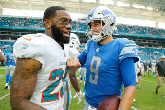 Lions QB Matthew Stafford talks with Dolphins DB Xavien Howard after the Lions' 32-21 win on Sunday, Oct. 21, 2018, in Miami Gardens, Fla.
