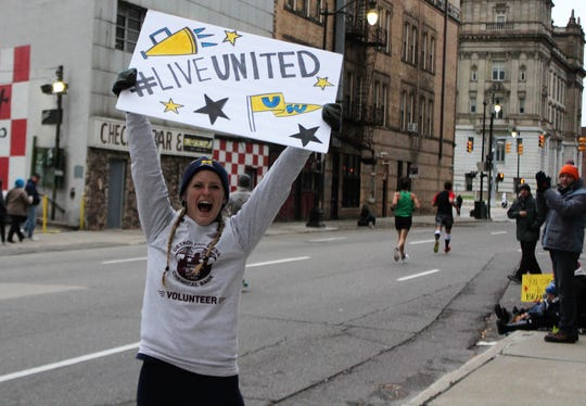 Megan McDonald of Livonia cheers on racers at the halfway point of Sunday's Detroit Free Press/Chemical Bank Marathon.