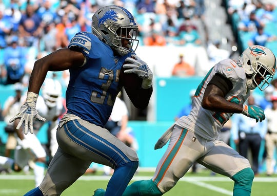 Lions running back Kerryon Johnson runs the ball against the Dolphins during the first half on Sunday, Oct. 21, 2018, in Miami Gardens, Fla.