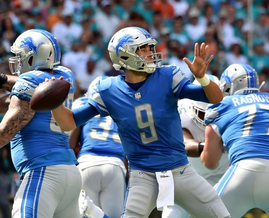 Matthew Stafford throws a pass against the Dolphins during the first half.