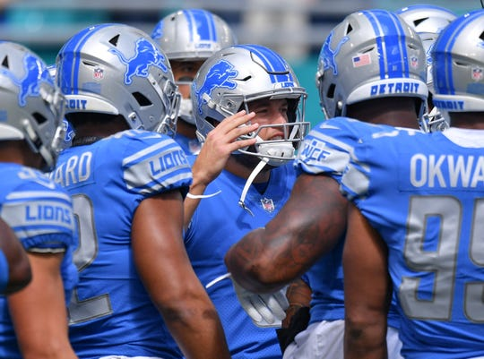 Lions quarterback Matthew Stafford huddles with teammates before the game against the Miami Dolphins on Sunday, Oct. 21, 2018, in Miami Gardens, Fla.