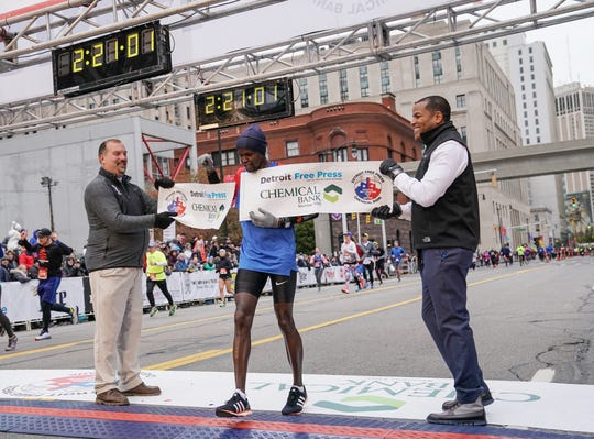 Christopher Kipyego of Zacatecas crosses the finish line in first place for the men during the 41st Annual Detroit Free Press/Chemical Bank Marathon in Detroit on Sunday, Oct. 21, 2018.