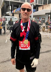 Barney Judge, 60, of Ann Arbor, sported a Colin Kaepernick jersey while running a half-marathon in the 41st Detroit Free Press/Chemical Bank Marathon on Sunday, Oct. 21, 2018.