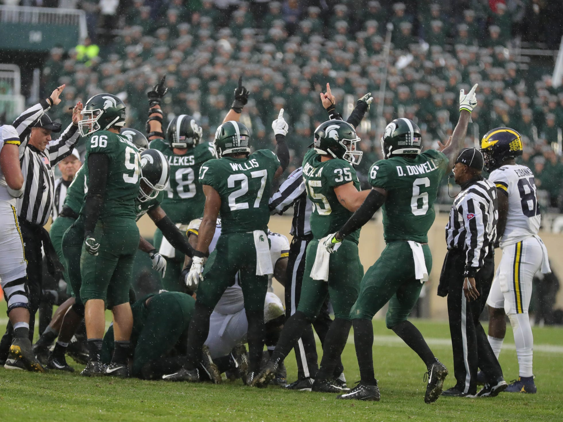 Michigan State celebrates after recovering a Michigan fumble during the second half Saturday, Oct. 20, 2018 at Spartan Stadium in East Lansing.