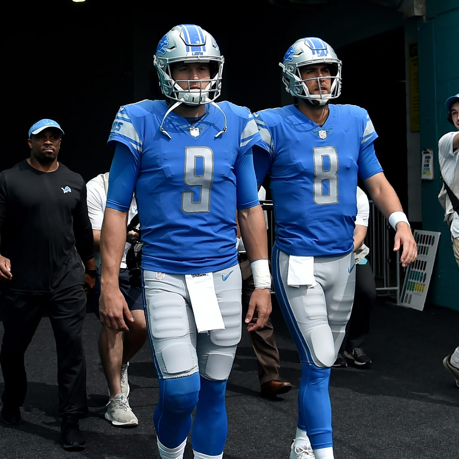 Lions quarterbacks Matthew Stafford (left) and Matt Cassel both take the field prior to a game against the Miami Dolphins at Hard Rock Stadium on Sunday, Oct. 21, 2018, in Miami Gardens, Fla.