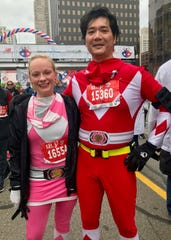 August Wong, 48, of Royal Oak, and Christine Paul, 28, of Detroit ran the international half-marathon while dressed as Power Rangers on Sunday, Oct. 21, 2018.