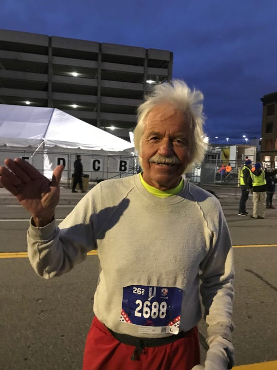 Dan Dewey, 72, of Lake Orion is one the last runners to start the 2018 Detroit Free Press/Chemical Bank International Marathon on Oct. 21, 2018.