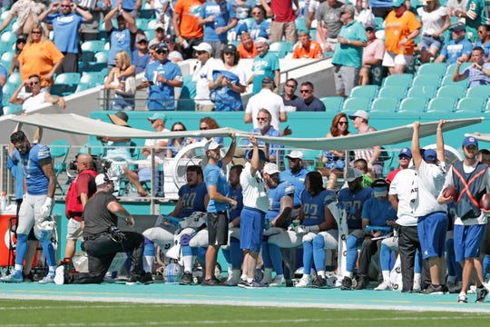Lions players try to stay cool during the game Sunday.