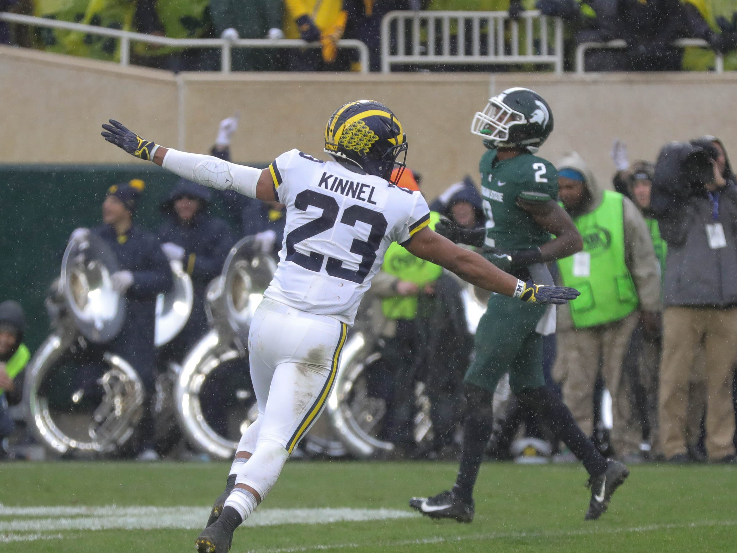 Michigan's Tyree Kinnel celebrates the 21-7 win over Michigan State, Saturday, Oct. 20, 2018 at Spartan Stadium in East Lansing.