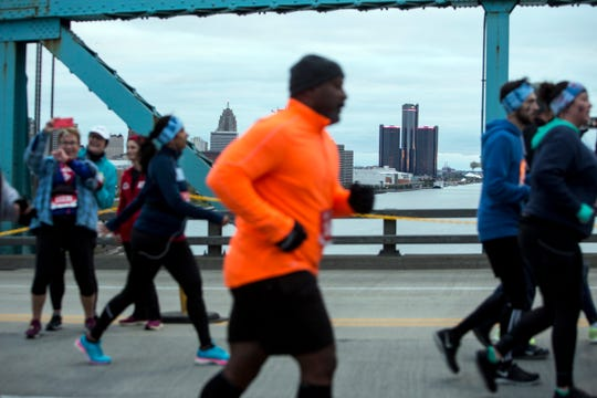 Runners cross the Ambassador Bridge during the 41st Annual Detroit Free Press/Chemical Bank Marathon in Detroit on Sunday, Oct. 21, 2018.